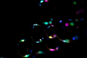 beautiful colourful soap bubbles on black background