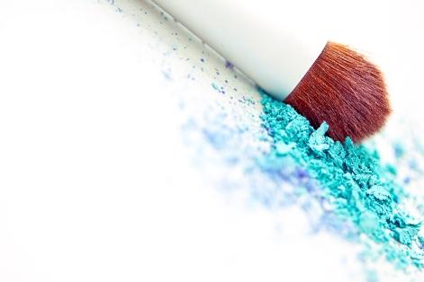 blue eyeshadow make-up powder and brush with shallow dof