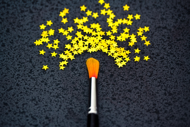 concept of success: brush painting stars