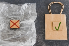 sustainable materials and packaging themed still-life with plastic wrapping crossed out vs paper bag with green tick