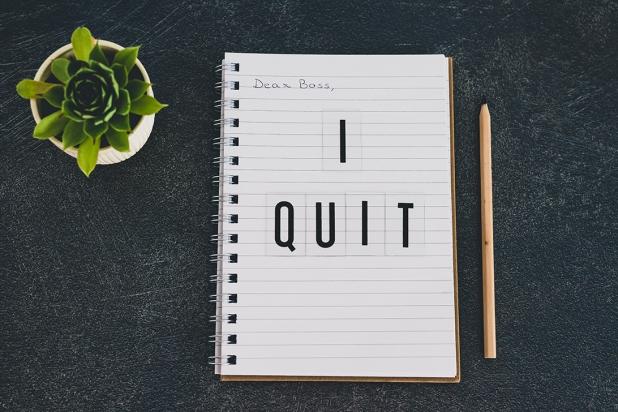 leaving a corporate job conceptual still-life, dear boss I quit message on notebook
