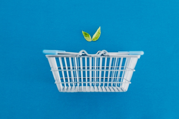 environmentally conscious consumer choices conceptual illustration, shopping basket with leaves metaphor of vegan plant-based and eco-friendly products and diet